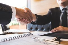 Successful job interview with boss and employee shaking hands after negotiation or interview, career and placement concept stock photography