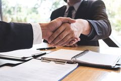 Successful job interview with boss and employee shaking hands after negotiation or interview, career and placement concept royalty free stock photo