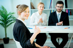 Successful job interview. A candidate is clasping her hands after her success Stock Photo