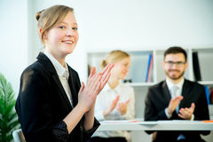 Successful job interview. A candidate is clasping her hands after her success Stock Images