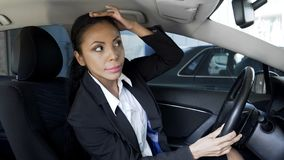 Successful lady boss smartening hairstyle up, looking into car mirror, beauty royalty free stock photos