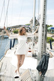 A successful lady on a yacht Royalty Free Stock Photos