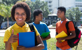 Successful latin american female student with friends Stock Photo