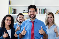 Successful latin hipster businessman with group of men and businesswomen royalty free stock photo