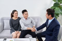 Successful lawyer giving consultation to family couple about buying house royalty free stock photos
