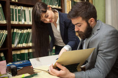successful lawyers or businessman read important documents,indoor stock photography