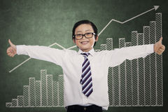 Successful little businessman showing thumbs up Stock Image