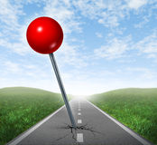 Successful Location Direction. Business symbol with a red push pin pinned and marked on a perspective oriented asphalt road  as an icon of vision and achieving Stock Images