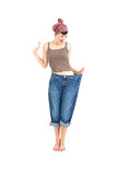Successful losing weight - woman in big trousers Stock Image