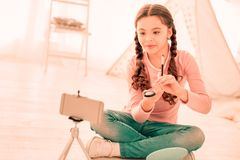 Pleasant cute girl sitting in her room stock image