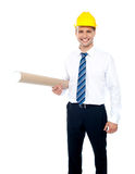 Successful male builder holding blueprints Stock Photo