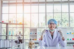 A successful male chemist is examining his new innovation in a laboratory. This breakthrough substance is to be used in medical industry royalty free stock photos