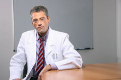 Successful male doctor. Sitting in the office Royalty Free Stock Image