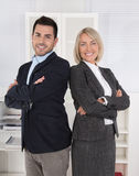 Successful male and female business team: senior and junior mana Royalty Free Stock Images