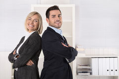 Successful male and female business team: senior and junior mana Royalty Free Stock Photography