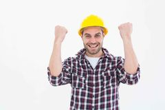 Successful male handyman clenching fists. Portrait of successful male handyman clenching fists on white background Stock Photo