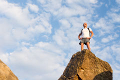 Successful male hiker standing on the mountain top Stock Images