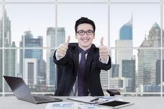 Successful male manager giving thumbs up Stock Image