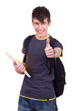 Successful male student. Portrait of a young successful student holding thumbs up royalty free stock photo