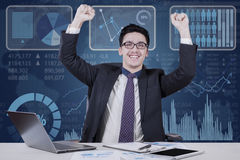 Successful male worker celebrate his achievement Stock Images