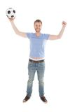 Successful Man With Arms Raised Holding Soccer Ball Stock Photo