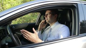 Successful man in car talking on cell phone stock footage