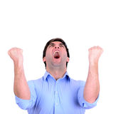 Successful man celebrating with arms up and shouting of joy isol Stock Photos