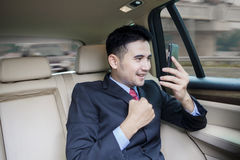 Successful man with cellphone in car. Portrait of successful businessman talking on the mobile phone inside the car Royalty Free Stock Photos