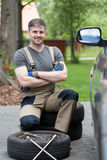 Successful man before changing car wheel Royalty Free Stock Photography