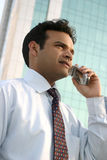 Successful man doing business on mobile phone Royalty Free Stock Image