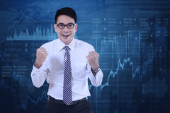 Successful man with financial statistics Stock Photos