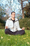 Successful man finding peaceful freedom in park Stock Photo