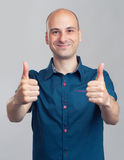 Successful man gesturing his thumbs up Stock Photo