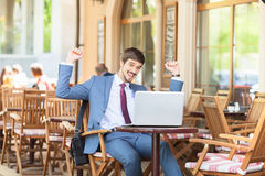 Successful man hands up outdoor at cafe Stock Photography