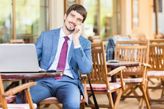 Successful man hands up outdoor at cafe Stock Image