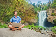 Successful man with laptop in a jungle Royalty Free Stock Photo