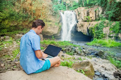 Successful man with laptop outdoors Royalty Free Stock Image