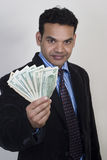Successful man with money Royalty Free Stock Photos