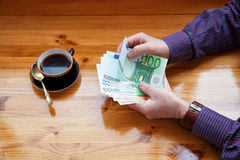 Successful man with the money and cup of coffee Royalty Free Stock Images