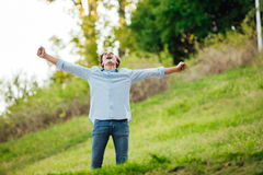 Successful man with open arms celebrating Stock Photo