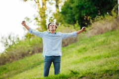 Successful man with open arms celebrating Royalty Free Stock Photo