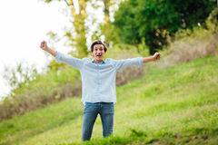 Successful man with open arms celebrating Royalty Free Stock Photography