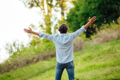Successful man with open arms celebrating Stock Image