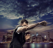 Successful man over the city background Stock Photo