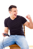 Successful man playing computer game with joystick Stock Photo