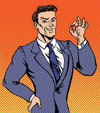 Successful Man in Pop Art Style Gesturing Okay Stock Photography