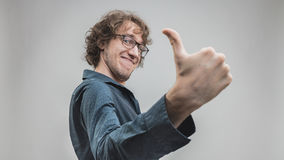 Successful man portrait with a thumb up stock images