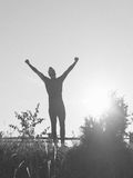 Successful man raising arms after cross track running Royalty Free Stock Image