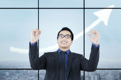 Successful man with rising upward arrow Stock Images