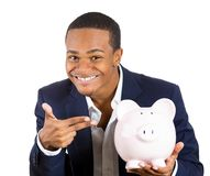 Successful man showing his piggy bank Royalty Free Stock Photo